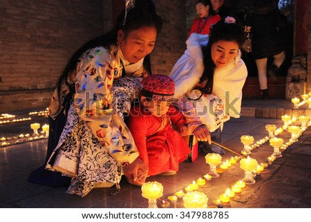 On December 6, 2015, xi 'an guang ren temple held the Lantern Festival, temple monks and tourists lit SuYouDeng, blessing world peace and happy life.