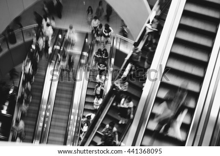 On escalator have peoples motion blurred with black and white