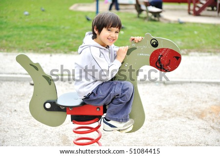 on horse in park - stock photo