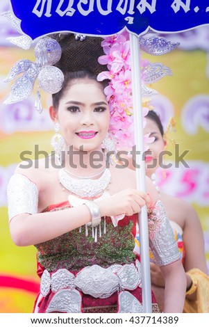 On June 11, 2016, women in Thailand Thailand beautiful red silk dress holding a sign procession in Bangkok, Thailand.
