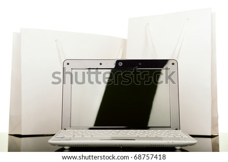 On line Internet Shopping, style laptop and white gift bag - stock photo