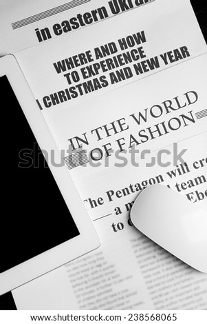 On-line news concept.Computer mouse, PC tablet and newspaper, close-up - stock photo