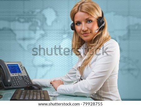 on-line suport call center attractive blue eyed blonde talking hands free device - stock photo
