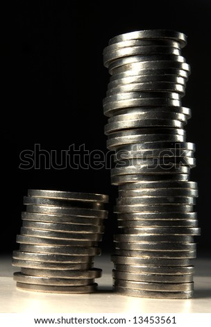 on long and one short stack of coins - stock photo