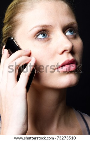 on phone - stock photo