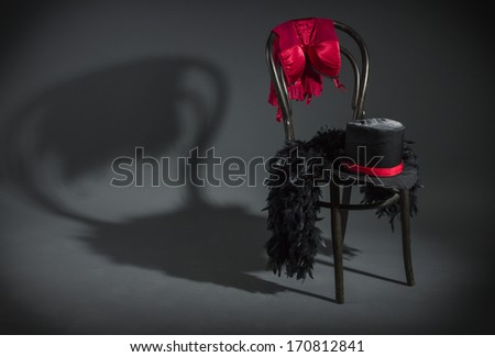 On retro chair is a cabaret dancer clothing. - stock photo