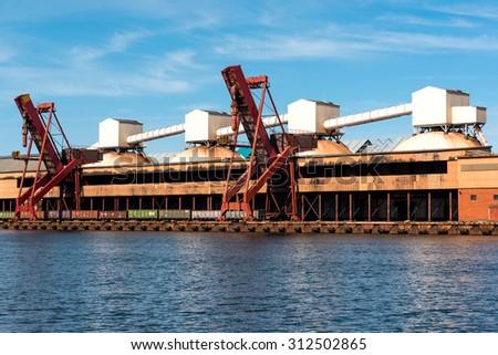 On-shore coal cargo terminal with heavy duty conveyor - stock photo