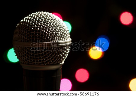 On stage microphone of a popular artist with spot lights - stock photo