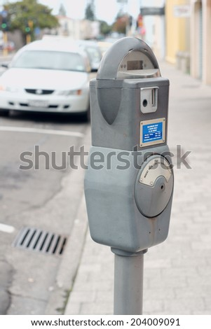 On street parking meter in an urban setting - stock photo