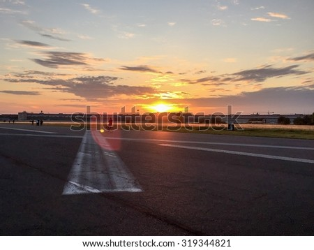 On Tempelhofer Feld on a summer evening in Berlin, Germany. - stock photo