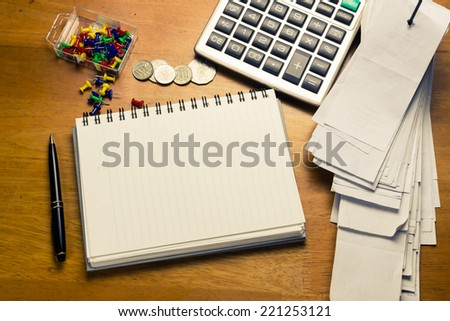 On the accountant desk with empty page of spiral notebook for place text - stock photo