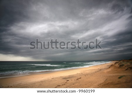 on the beach before a powerful storm - stock photo