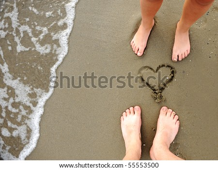 On the beach, two lovers