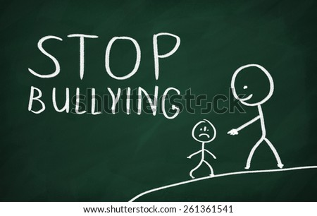 On the blackboard draw character and write Stop bullying - stock photo