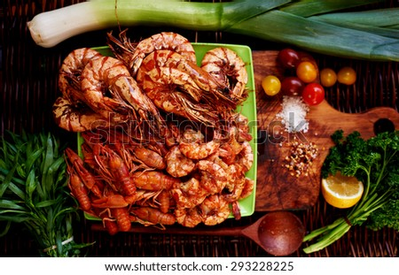 On the bright green plate lined with a great appetizer to any table, shrimp, prawns, tiger prawns, crabs, lie next to a slice of lemon, you can add them to taste for seafood - stock photo