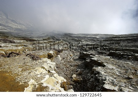 On the crater rim of the volcano Iljen. Volcanic Landscape with ash at Mt Iljen at Java, in Indonesia. - stock photo