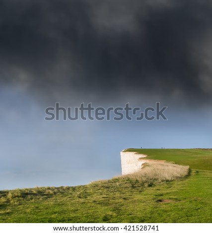 On the edge.Beachy Head. Chalk headland in East Sussex, England. Close to Eastbourne, immediately east of the Seven Sisters.  The cliff is the highest chalk sea cliff in Britain, rising to 162 metres  - stock photo