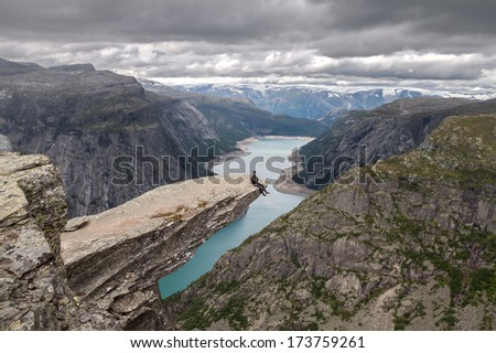 On the Edge. Trolltunga, Norway. Canon 5D. - stock photo