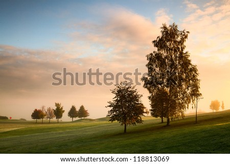 On the golf course in autumn in the mist in Prague - stock photo