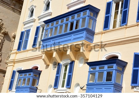 On the island of Malta, in Valletta, the maltese buildings are characterized by their magnificent balconies of wood covered and of various colors, very typical and characteristic of this city. - stock photo