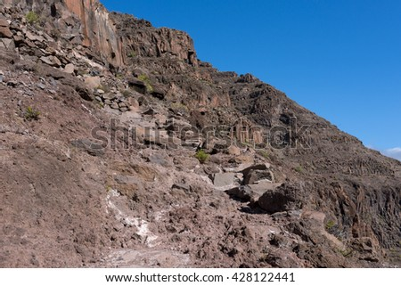 On the long distance trail from the Valle Gran Rey to the village Arure in the highlands of the Canary island La Gomera. 850m up on serpentine to the La Merica plateau on top of the mountain - stock photo