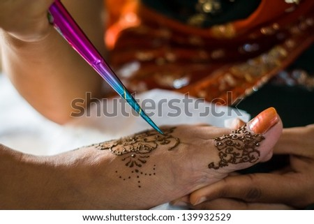 "On the ""Night of Mehndi"" the bride's feet are decorated with elaborate designs with henna tattoo before the night of the wedding"