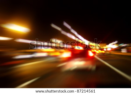 On the night road. Motion blurred image - stock photo