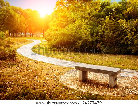 On the outskirts of the autumn, the golden landscape, winding path. - stock photo