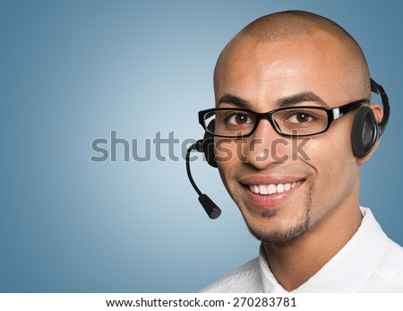 On The Phone. Call center executive wearing a headset with copyspace - stock photo