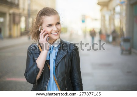 On the phone in city on sunset - stock photo