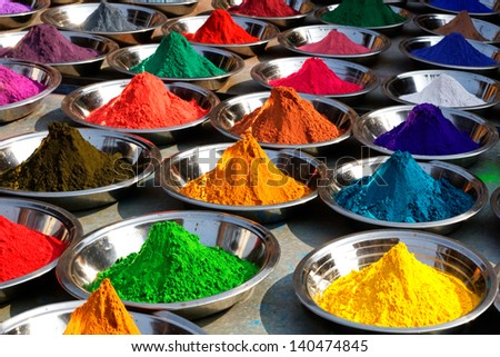 On the photo: Colorful tika powders on Orcha market, India - stock photo