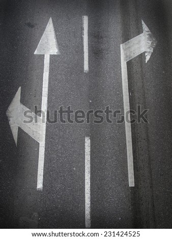 on the road arrows - stock photo