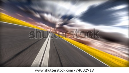 On the road.Concept of speed with motion effect