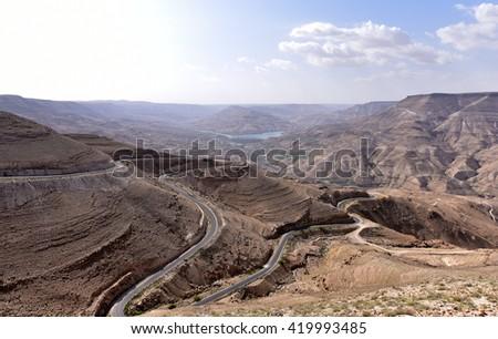 On the road full of turns to Wadi Mujib in Jordan - stock photo