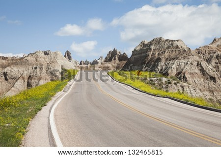 On the road in Badlands National Park, South Dakota, USA - stock photo