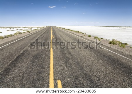 On the road to the Bonneville Speedway, Bonneville Salt Flats near Wendover, Utah, United States - stock photo