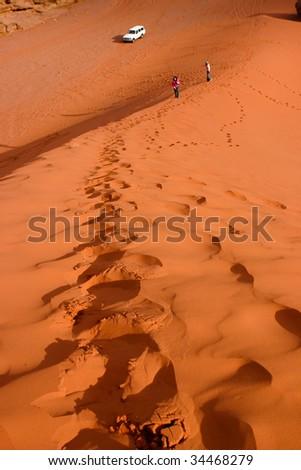 on the sand dune of Wadi Rum - stock photo