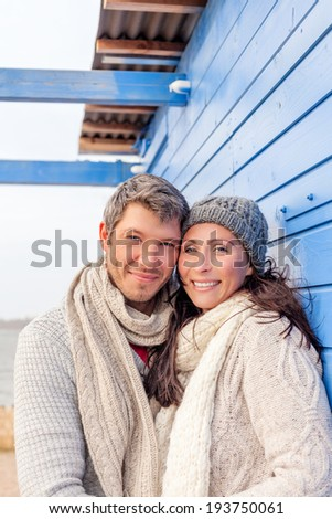 on the sea house relaxing winter pair - stock photo
