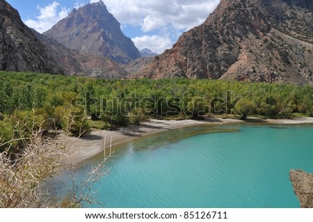 On the shores of Iskander Kul lake in Tajikistan - in the footsteps of Alexander the Great in Central Asia - stock photo