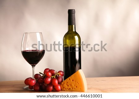 on the table a bottle of wine and a glass of - stock photo