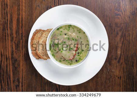 on the table a plate of soup, bread croutons - stock photo