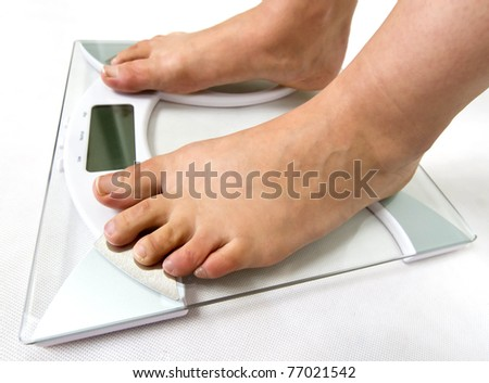 On the weight scale - stock photo