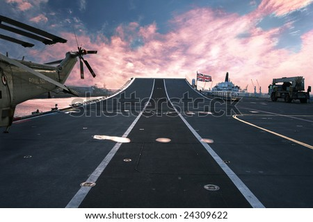 On top of HMS Ark Royal aircraft carrier and flagship of the British Royal Navy at sunset - stock photo