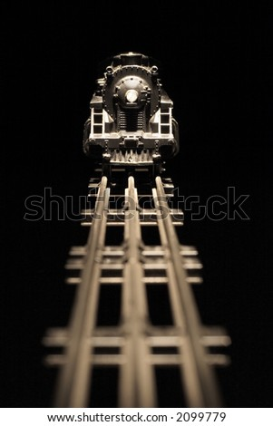 On Track (Old worn model train engine with nicks and scratches, focus on model train) - stock photo