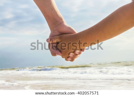 on vacation two join hands
