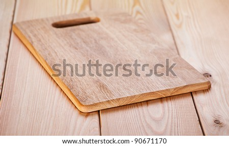 on wooden table top wooden cutting board - stock photo