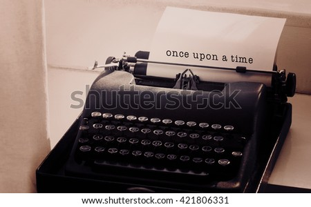 Once upon a time message on a white background against typewriter on a table - stock photo