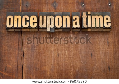 once upon a time opening phrase - storytelling concept - vintage letterpress wood type text against grunge weathered wooden background - stock photo