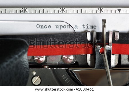 Once upon a time typed on an old antique typewriter - stock photo