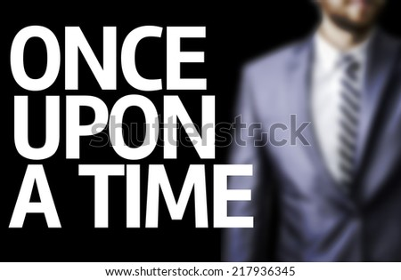 Once Upon A Time written on a board with a business man on background - stock photo